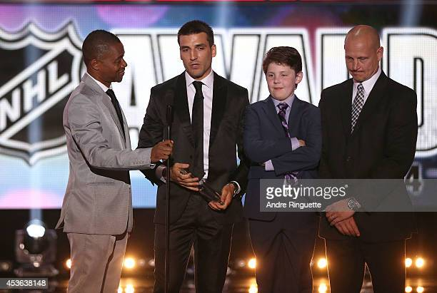 Actor Cuba Gooding Jr Patrice Bergeron of the Boston Bruins winner of the NHL Foundation Player Award and the Frank J Selke Trophy youth goaltender...