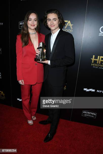 Actor Dakota Johnson poses with honoree Timothee Chalamet recipient of the Hollywood Breakout Performance Actor Award for 'Call Me By Your Name' in...
