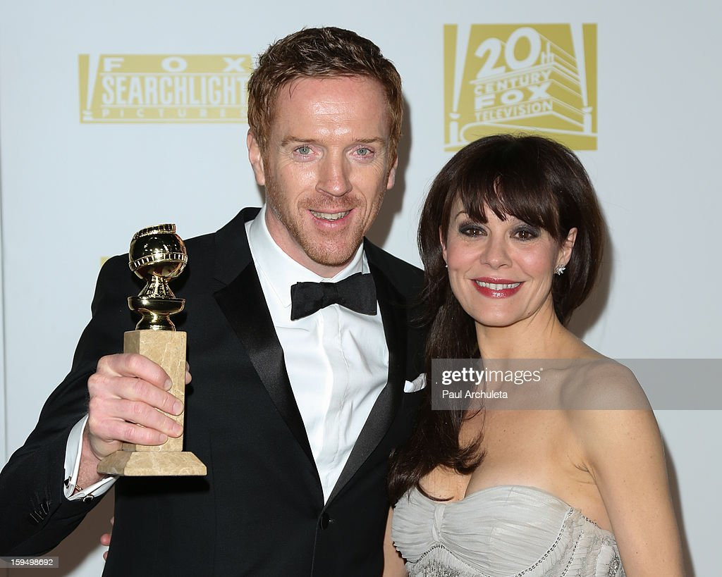 Actor Damian Lewis (L) and his wife Helen McCrory (R) attend the FOX after party for the 70th Golden Globes award show at The Beverly Hilton Hotel on January 13, 2013 in Beverly Hills, California.
