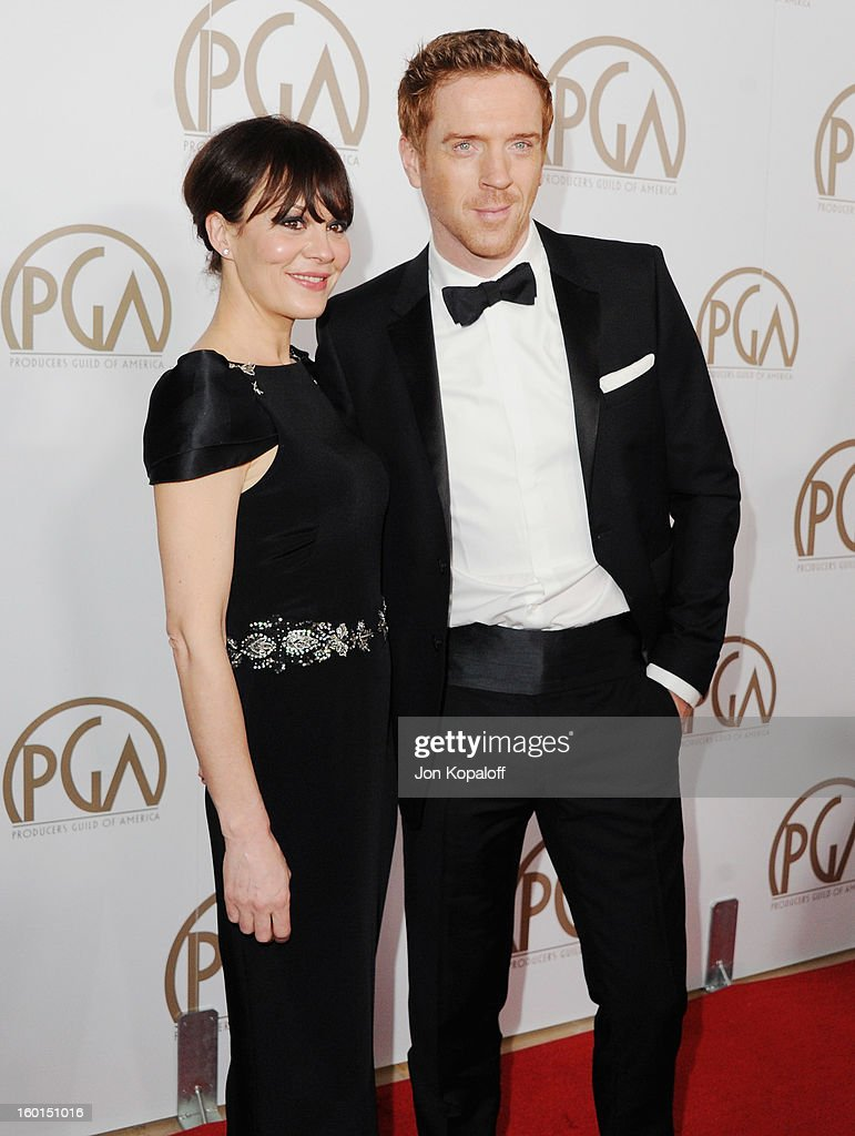 Actor Damian Lewis (R) and wife actress Helen McCrory arrive at the 24th Annual Producers Guild Awards at The Beverly Hilton Hotel on January 26, 2013 in Beverly Hills, California.