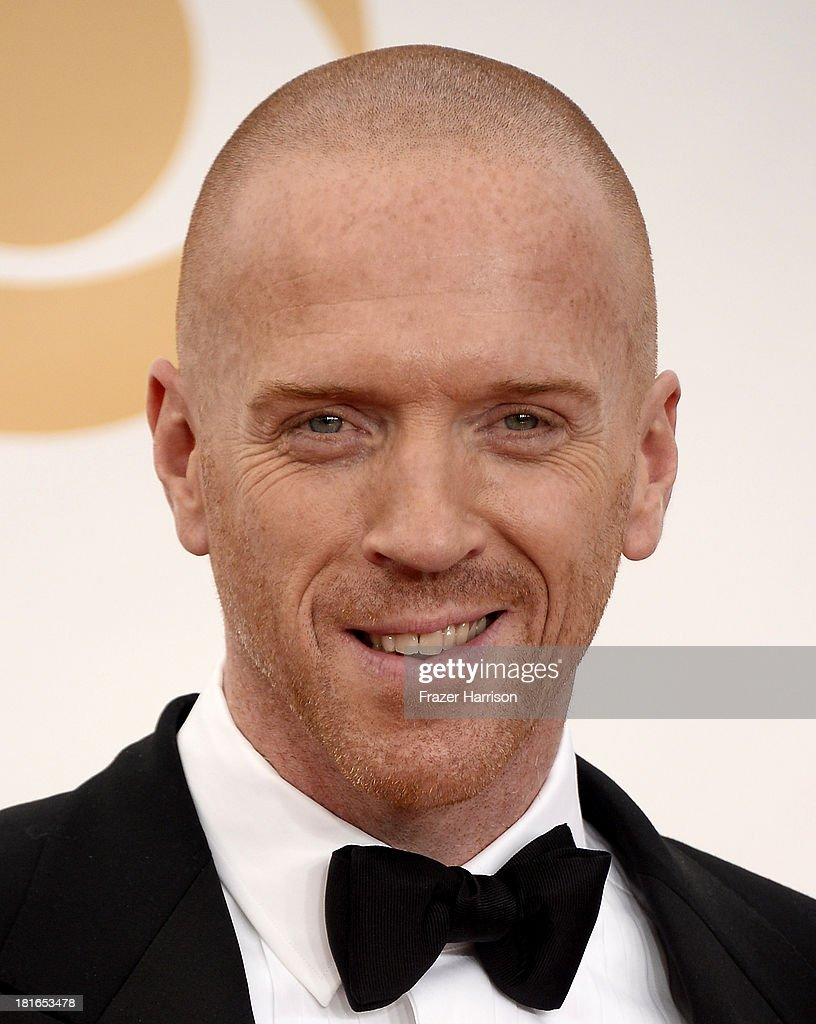 Actor <a gi-track='captionPersonalityLinkClicked' href=/galleries/search?phrase=Damian+Lewis&family=editorial&specificpeople=206939 ng-click='$event.stopPropagation()'>Damian Lewis</a> arrives at the 65th Annual Primetime Emmy Awards held at Nokia Theatre L.A. Live on September 22, 2013 in Los Angeles, California.
