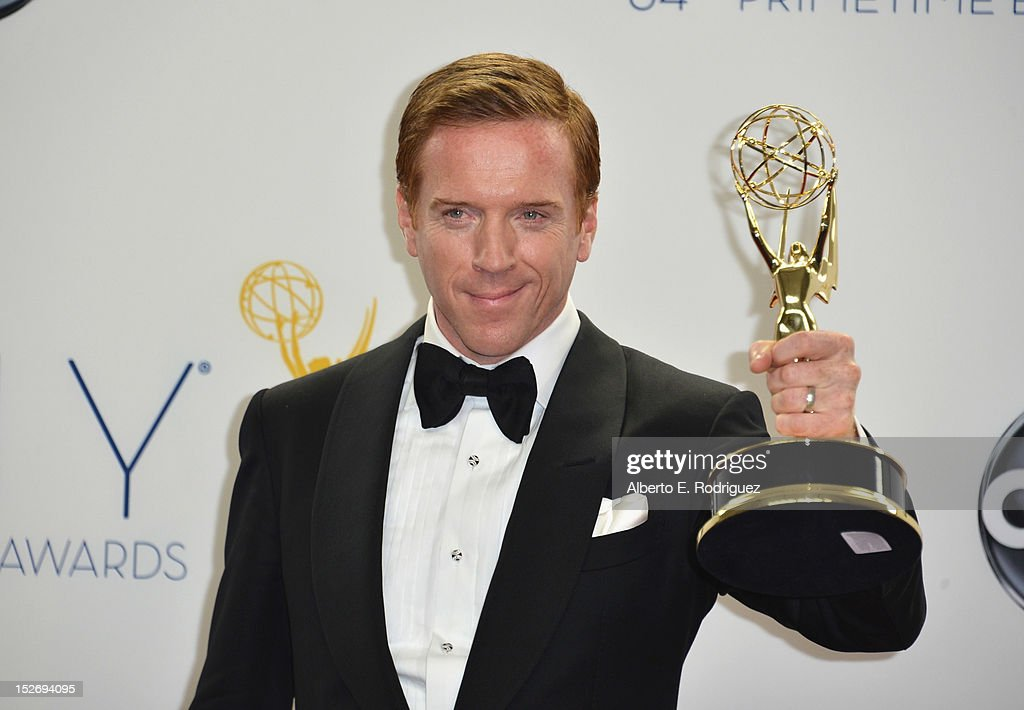 Actor <a gi-track='captionPersonalityLinkClicked' href=/galleries/search?phrase=Damian+Lewis&family=editorial&specificpeople=206939 ng-click='$event.stopPropagation()'>Damian Lewis</a> poses in the 64th Annual Emmy Awards press room at Nokia Theatre L.A. Live on September 23, 2012 in Los Angeles, California.