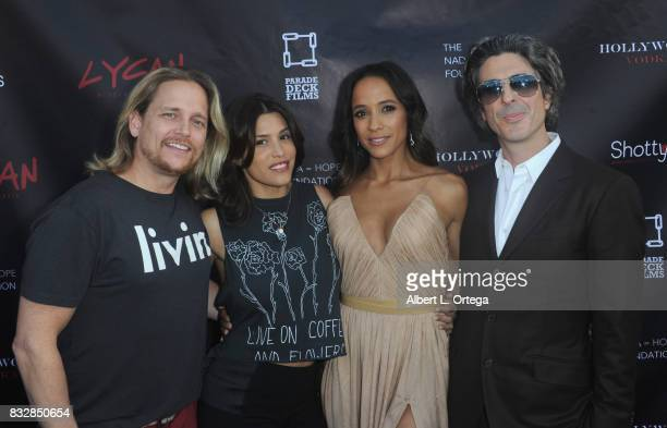 "Actor Damian Whitewood actress Rachel Sterling actress Dania Ramirez and director Bev Land arrive for the Premiere Of Parade Deck's ""Lycan"" held at..."