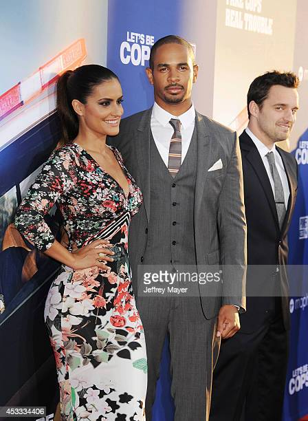 Actor Damon Wayans Jr and Samara Saraiva attend the 'Let's Be Cops' Los Angeles Premiere held at the ArcLight Hollywood on August 7 2014 in Hollywood...