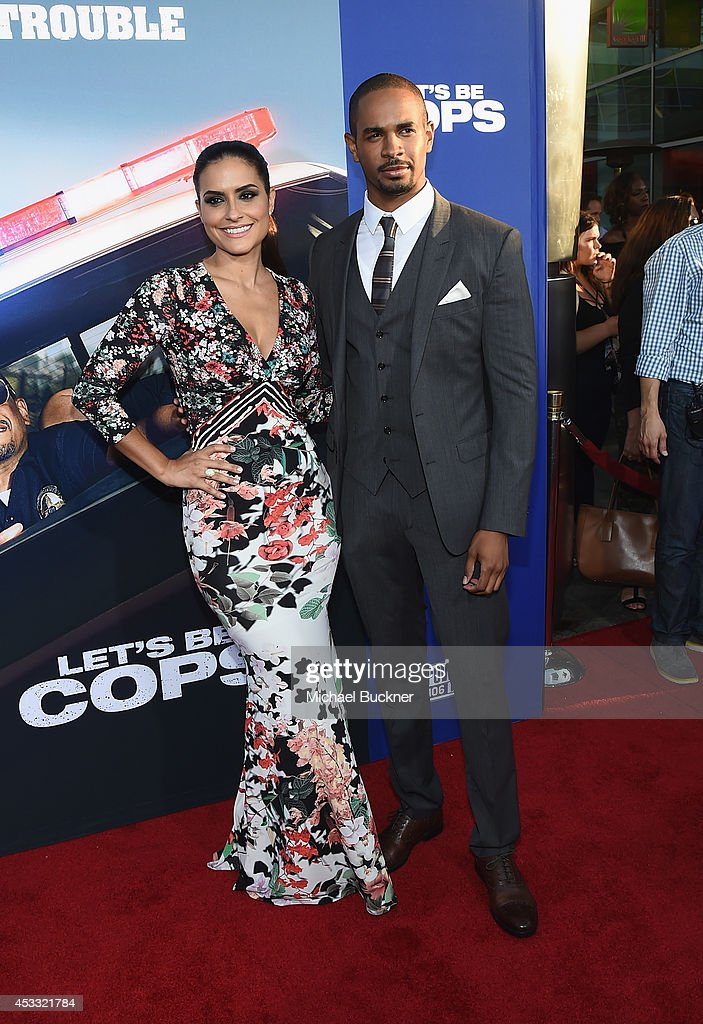 Actor Damon Wayns Jr. (R) and Samara Saraiva arrive at the premiere of Twentieth Century Fox's 'Let's Be Cops' at ArcLight Hollywood on August 7, 2014 in Hollywood, California.