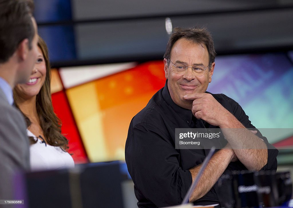 Actor Dan Ackroyd, co-founder of Crystal Head Vodka, listens during a Bloomberg Television interview in New York, U.S., on Wednesday, July 31, 2013. Founded with artist John Alexander, Crystal Head takes its name from the eerie skull-shaped bottle it comes in. Photographer: Jin Lee/Bloomberg via Getty Images