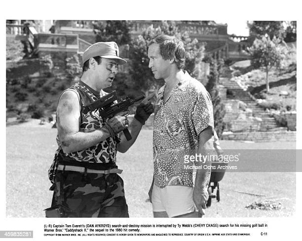 Actor Dan Aykroyd and Chevy Chase on set of the movie ' Caddyshack II ' circa 1988
