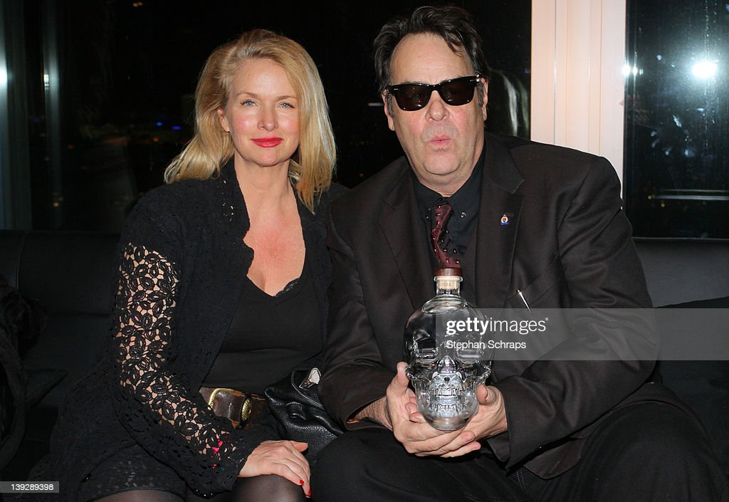 Actor <a gi-track='captionPersonalityLinkClicked' href=/galleries/search?phrase=Dan+Aykroyd&family=editorial&specificpeople=206819 ng-click='$event.stopPropagation()'>Dan Aykroyd</a> and wife <a gi-track='captionPersonalityLinkClicked' href=/galleries/search?phrase=Donna+Dixon&family=editorial&specificpeople=213651 ng-click='$event.stopPropagation()'>Donna Dixon</a> celebrating the launch of his 'Crystal Head Vodka' in the 'Puro Sky Lounge', Europacenter, February 18, 2012 in Berlin, Germany.
