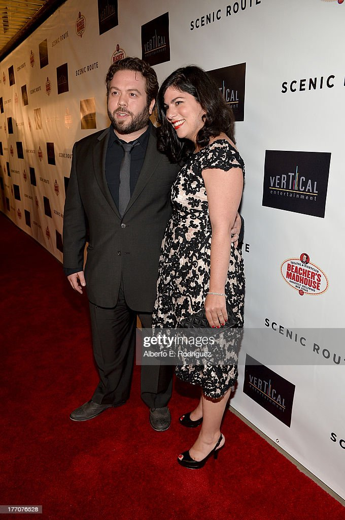 Actor Dan Fogler (L) and Jodie Capes Fogler arrives at the premiere of Vertical Entertainment's 'Scenic Route' at Chinese 6 Theater- Hollywood on August 20, 2013 in Hollywood, California.