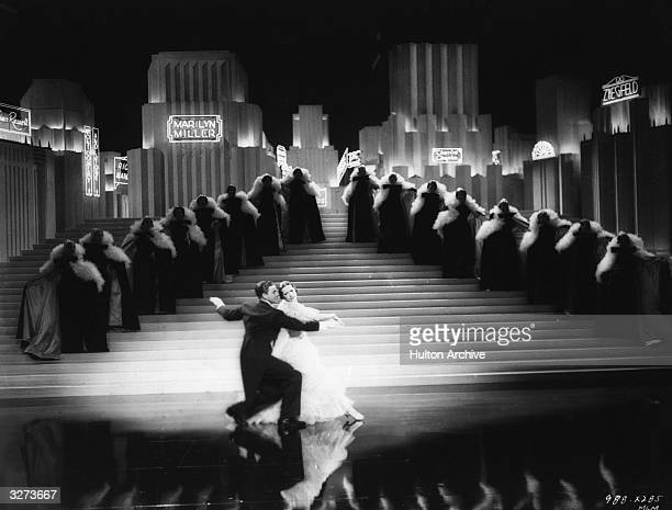 Actor dancer and politician George Murphy dances with Eleanor Powell in the MGM film 'Broadway Melody Of 1938' directed by Roy Del Ruth