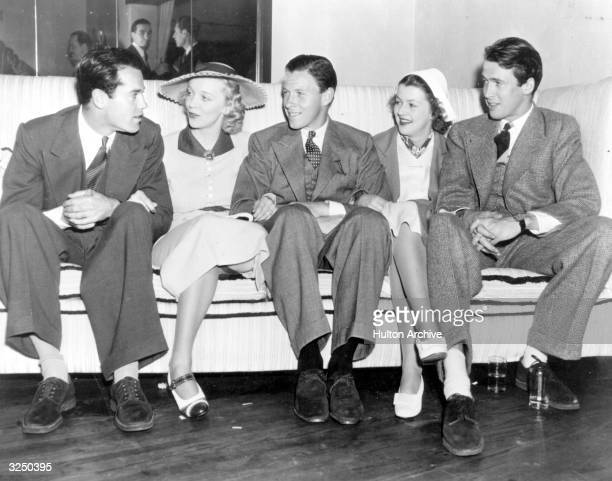 Actor dancer and politician George Murphy with Henry Fonda Virginia Bruce Betty Furness and James Stewart at the new West Side Tennis Club