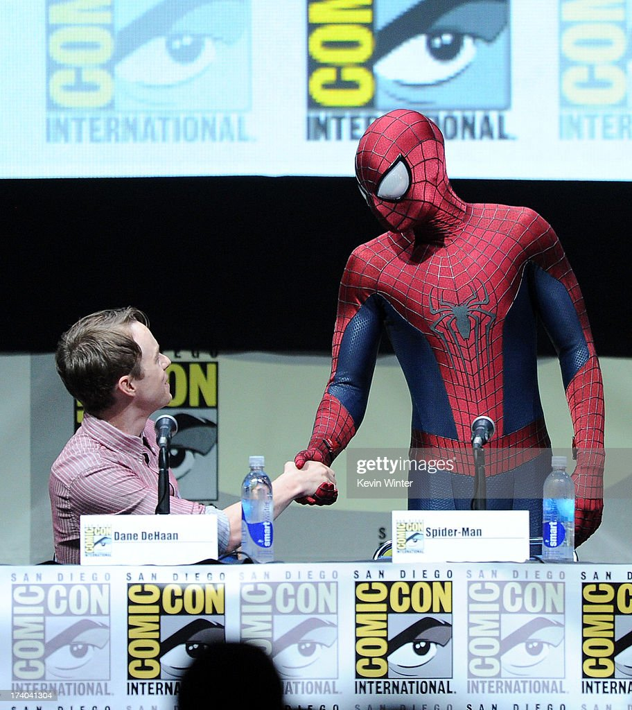 Actor Dane DeHaan (L) and Spider-Man speak onstage at the Sony and Screen Gems panel for 'The Amazing Spider-Man 2' during Comic-Con International 2013 at San Diego Convention Center on July 19, 2013 in San Diego, California.