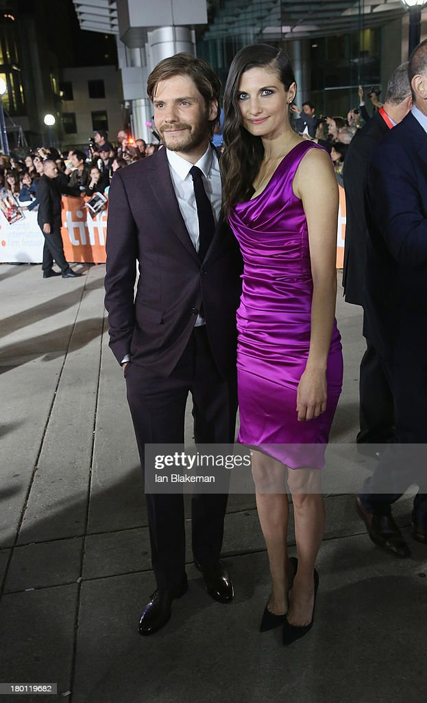 Actor Daniel Brühl and girlfriend Felicitas Rombold attend the 'Rush' premiere during the 2013 Toronto International Film Festival at Roy Thomson Hall on September 8, 2013 in Toronto, Canada.