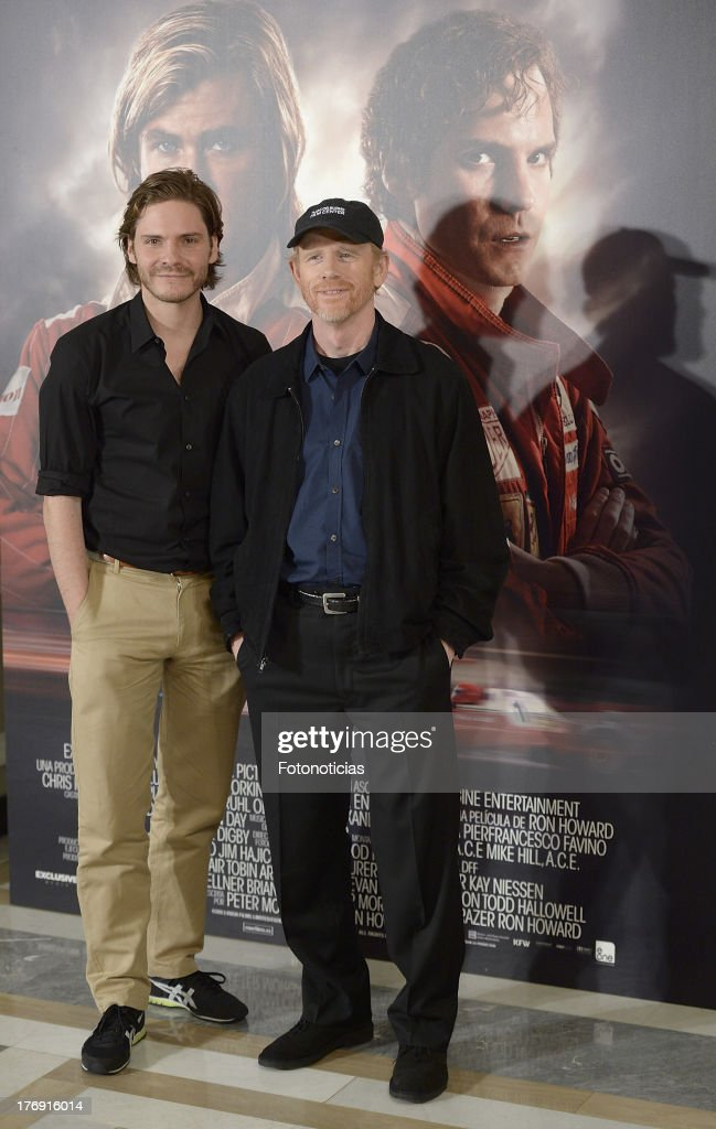 Actor Daniel Bruhl and director <a gi-track='captionPersonalityLinkClicked' href=/galleries/search?phrase=Ron+Howard+-+Director&family=editorial&specificpeople=201972 ng-click='$event.stopPropagation()'>Ron Howard</a> attend a photocall for 'Rush' at Villamagna Hotel on August 19, 2013 in Madrid, Spain.