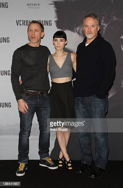 Actor Daniel Craig actress Rooney Mara and director David Fincher pose at the photocall of the film 'The Girl With the Dragon Tattoo' on January 5...