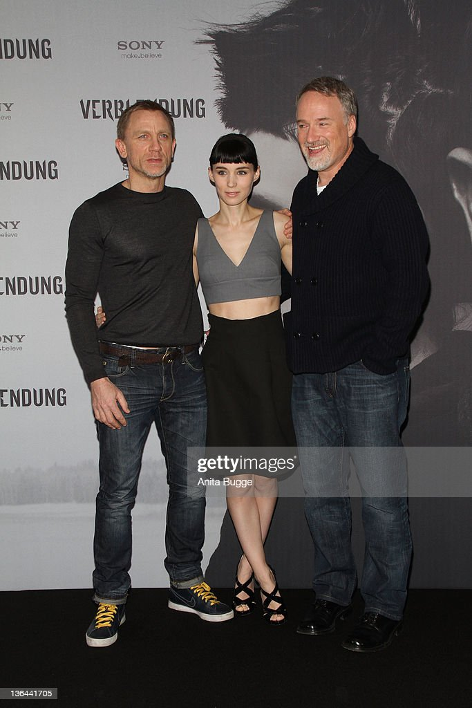 Actor Daniel Craig, actress <a gi-track='captionPersonalityLinkClicked' href=/galleries/search?phrase=Rooney+Mara&family=editorial&specificpeople=5669181 ng-click='$event.stopPropagation()'>Rooney Mara</a> and director <a gi-track='captionPersonalityLinkClicked' href=/galleries/search?phrase=David+Fincher&family=editorial&specificpeople=1660487 ng-click='$event.stopPropagation()'>David Fincher</a> pose at the photocall of the film 'The Girl With the Dragon Tattoo' ('Verblendung') on January 5, 2012 in Berlin, Germany.