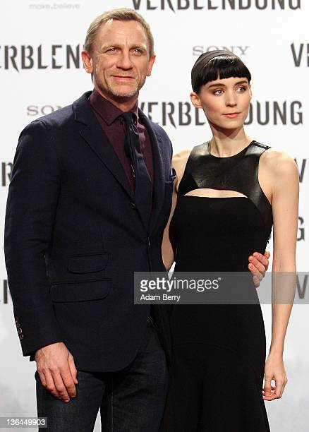 Actor Daniel Craig and actress Rooney Mara arrive for the German premiere of the film 'The Girl With the Dragon Tattoo' the first part of a series of...