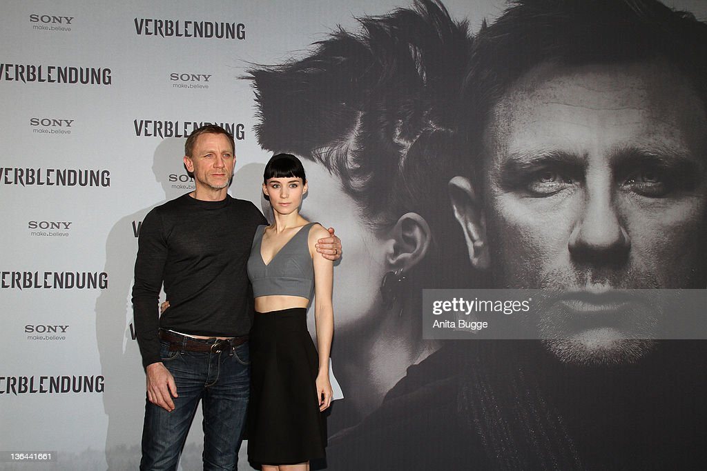 Actor Daniel Craig and actress <a gi-track='captionPersonalityLinkClicked' href=/galleries/search?phrase=Rooney+Mara&family=editorial&specificpeople=5669181 ng-click='$event.stopPropagation()'>Rooney Mara</a> pose at the photocall of the film 'The Girl With the Dragon Tattoo' ('Verblendung') on January 5, 2012 in Berlin, Germany.