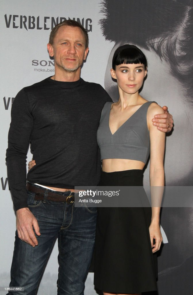 Actor Daniel Craig and actress Rooney Mara pose at the photocall of the film 'The Girl With the Dragon Tattoo' ('Verblendung') on January 5, 2012 in Berlin, Germany.