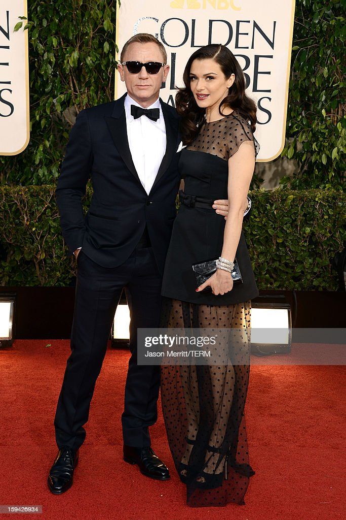 Actor Daniel Craig (L) and wife actress <a gi-track='captionPersonalityLinkClicked' href=/galleries/search?phrase=Rachel+Weisz&family=editorial&specificpeople=204656 ng-click='$event.stopPropagation()'>Rachel Weisz</a> arrive at the 70th Annual Golden Globe Awards held at The Beverly Hilton Hotel on January 13, 2013 in Beverly Hills, California.