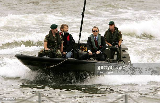 Actor Daniel Craig arrives by boat with Royal Marines as he is unveiled as the new actor to play the legendary British secret agent James Bond 007 in...