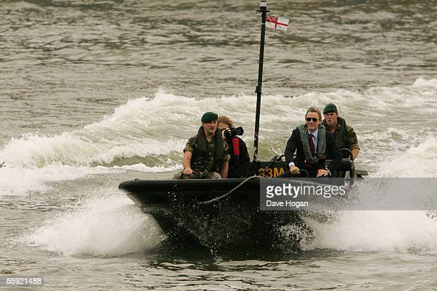Actor Daniel Craig arrives by boat with the Royal Marines as he is unveiled as the new actor to play the legendary British secret agent James Bond...
