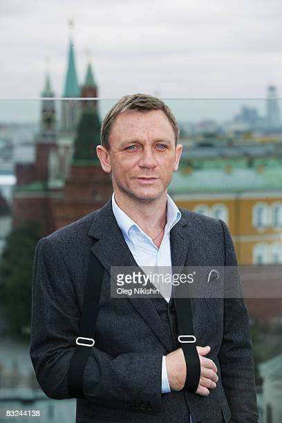 Actor Daniel Craig poses during a photocall for the new James Bond film 'Quanturm Of Solace' on the roof of RitzCarlton hotel with the Kremlin in the...