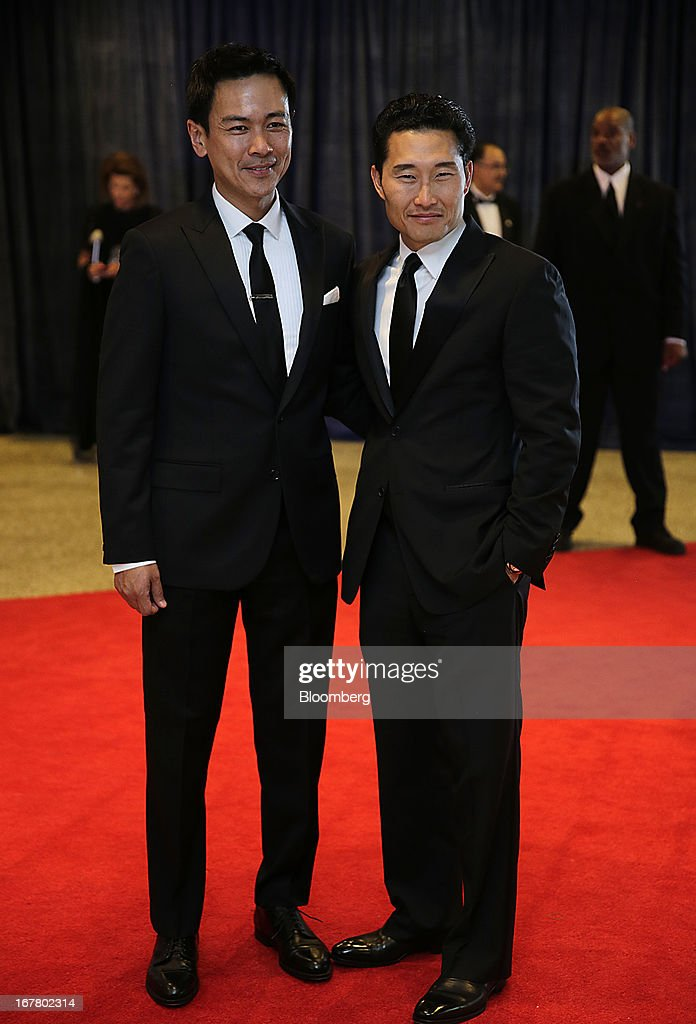 Actor Daniel Dae Kim, right, and guest arrive for the White House Correspondents' Association (WHCA) dinner in Washington, D.C., U.S., on Saturday, April 27, 2013. The 99th annual dinner raises money for WHCA scholarships and honors the recipients of the organization's journalism awards. Photographer: Scott Eells/Bloomberg via Getty Images