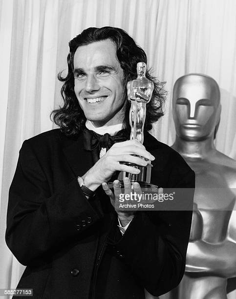 Actor Daniel Day Lewis holding his Best Actor Oscar for the film 'My Left Foot' at the 62nd Academy Awards Los Angeles March 26th 1990