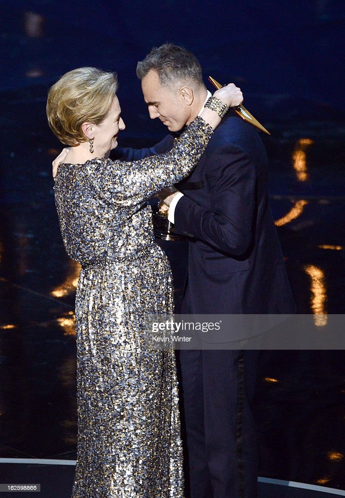 Actor Daniel Day-Lewis accepts the Best Actor award for 'Lincoln' from presenter Meryl Streep (L) onstage during the Oscars held at the Dolby Theatre on February 24, 2013 in Hollywood, California.