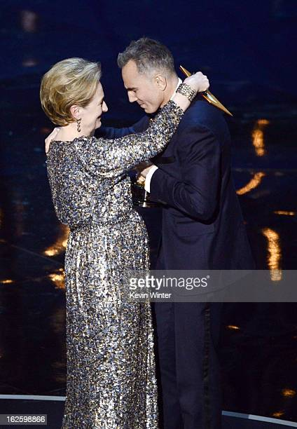 Actor Daniel DayLewis accepts the Best Actor award for 'Lincoln' from presenter Meryl Streep onstage during the Oscars held at the Dolby Theatre on...