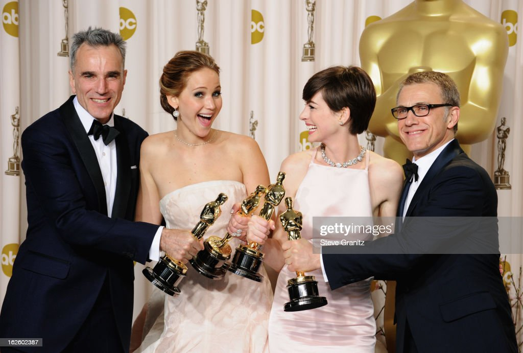 Actor Daniel Day-Lewis, actress Jennifer Lawrence, actress Anne Hathaway and actor Christoph Waltz poses in the press room during the Oscars at the Loews Hollywood Hotel on February 24, 2013 in Hollywood, California.