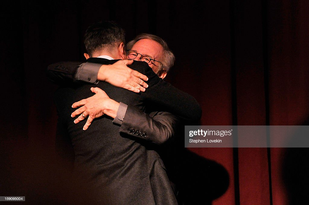 Actor Daniel Day-Lewis (L) and director Steven Spielberg share a hug onstage at the 2012 New York Film Critics Circle Awards at Crimson on January 7, 2013 in New York City.