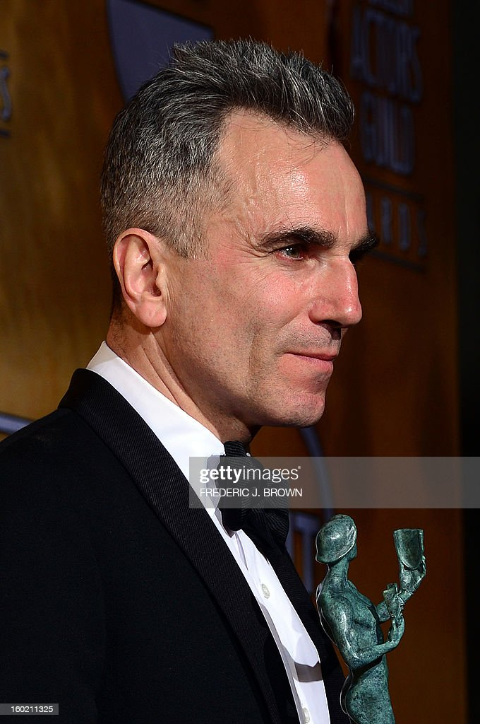 Actor Daniel Day-Lewis poses with the Screen Actors Guild trophy for Outstanding Performance by a Male Actor in a Leading Role in the press room at the Shrine Auditorium in Los Angeles on January 27, 2013. AFP PHOTO / Frederic J. BROWN
