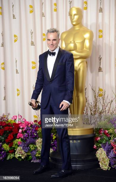 Actor Daniel DayLewis winner of the Best Actor award for 'Lincoln' poses in the press room during the Oscars held at Loews Hollywood Hotel on...