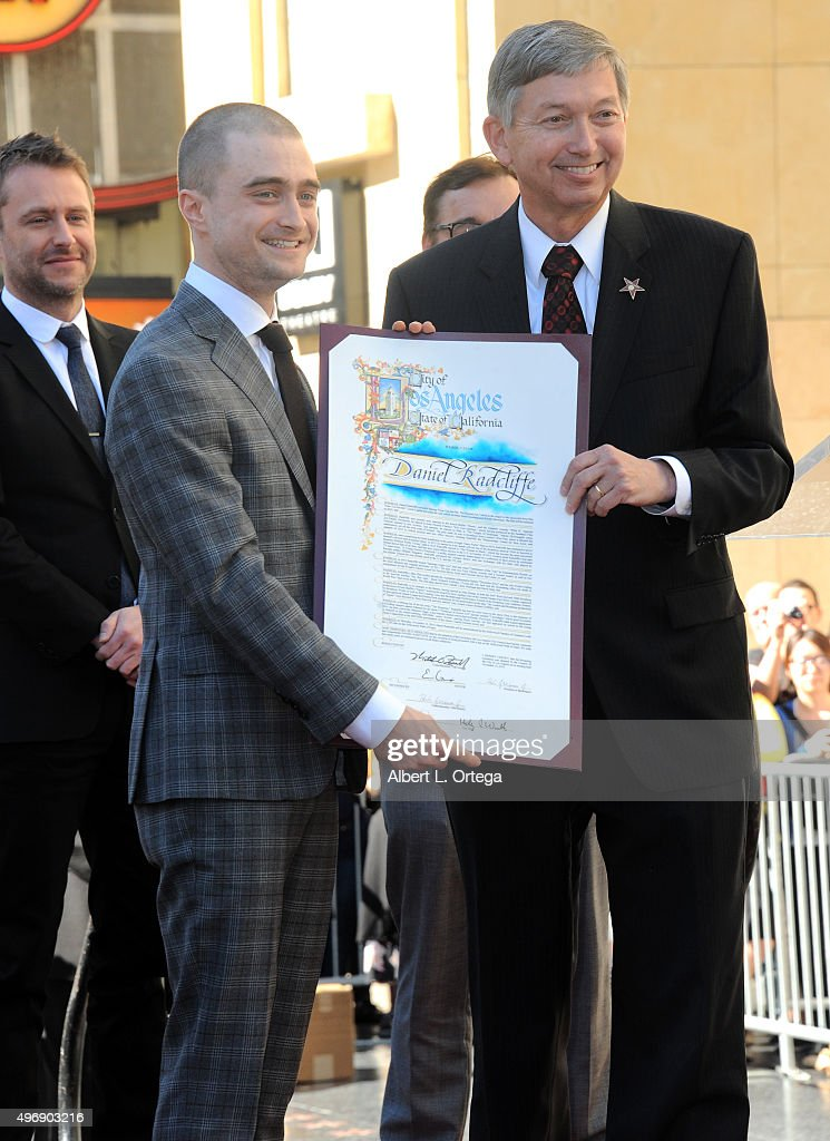 Actor Daniel Radcliffe accepts a proclamation from WOF President Leron Gubler at the Daniel Radcliffe's Star ceremony on the Hollywood Walk of Fame...
