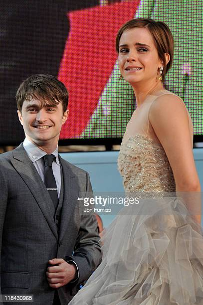 Actor Daniel Radcliffe and actress Emma Watson attend the 'Harry Potter And The Deathly Hallows Part 2' world premiere at Trafalgar Square on July 7...