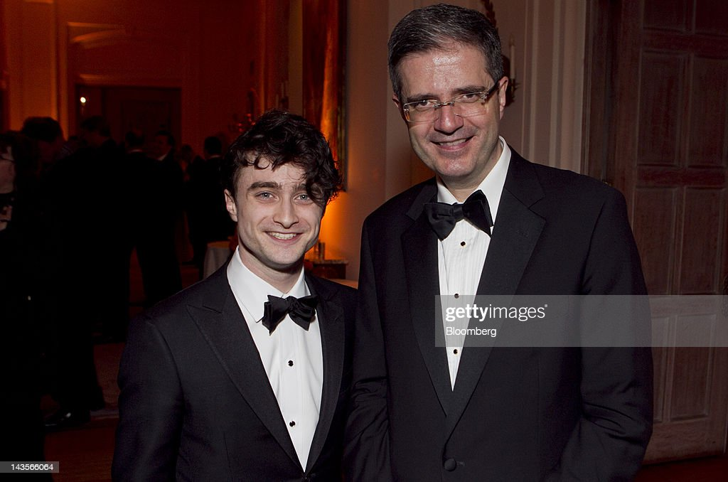 Actor Daniel Radcliffe, left, and Francois Delattre, France's Ambassador to the United States, attend the Bloomberg Vanity Fair White House Correspondents' Association (WHCA) Dinner afterparty in Washington, D.C., U.S., on Saturday, April 28, 2012. The 98th annual dinner raises money for WHCA scholarships and honors the recipients of the organization's journalism awards. Photographer: Andrew Harrer/Bloomberg via Getty Images