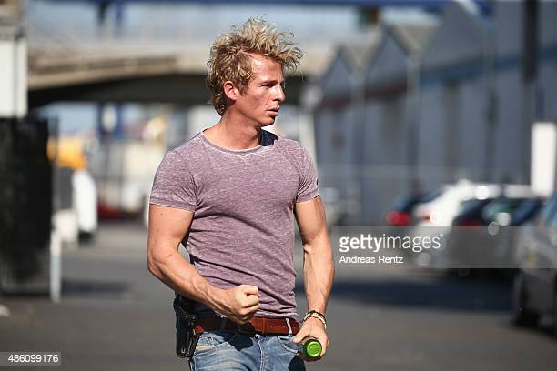Actor Daniel Roesner gestures during the photocall for the action series 'Alarm fuer Cobra 11' on August 31 2015 in Cologne Germany