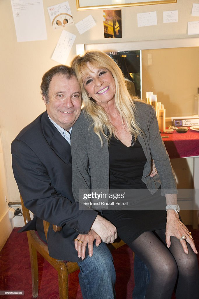 Actor Daniel Russo (L) and his wife Lucie pose in Russo's dressing room following the 100th performance of the play 'Hier Est Un Autre Jour' at Theatre des Bouffes Parisiens on May 11, 2013 in Paris, France.