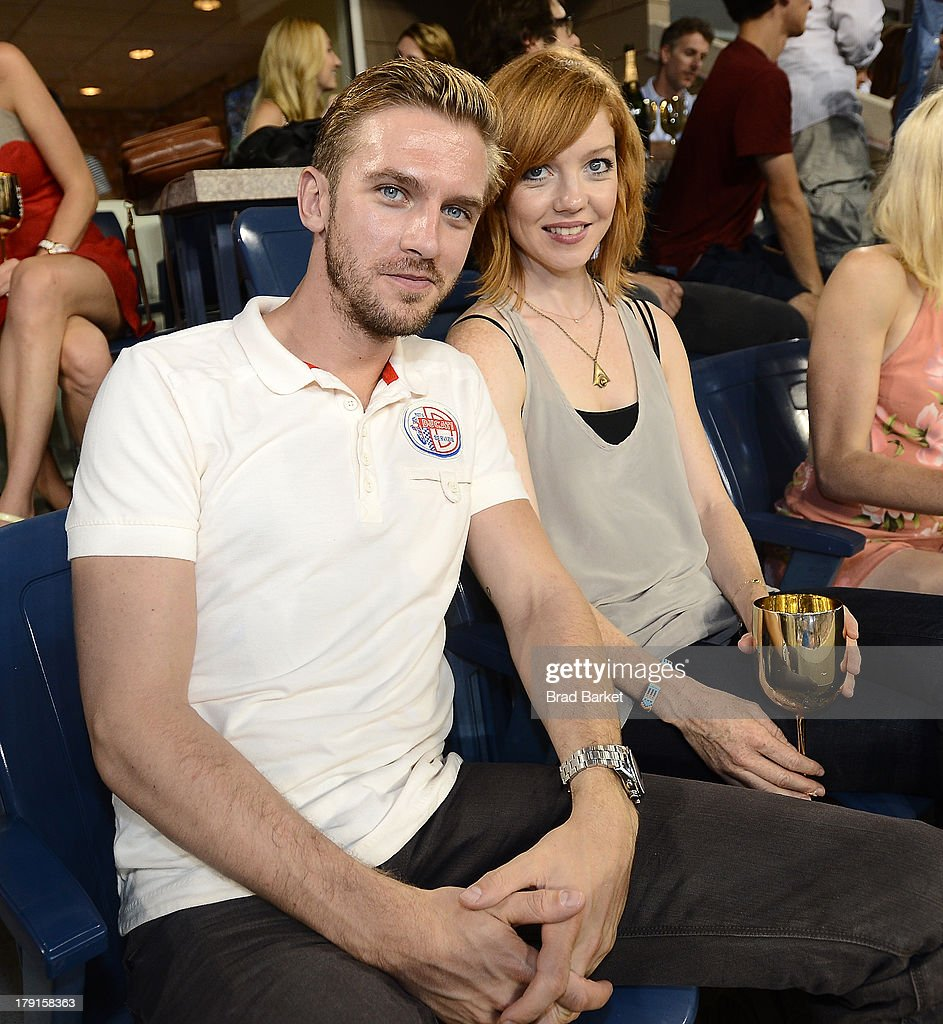 Actor Daniel Stevens(L) and Susie Hariet attend the Moet & Chandon Suite at USTA Billie Jean King National Tennis Center on August 31, 2013 in New York City.