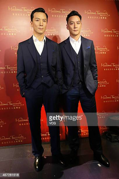 Actor Daniel Wu poses with his wax figure at Madame Tussauds Wax Museum on October 15 2014 in Hong Kong China
