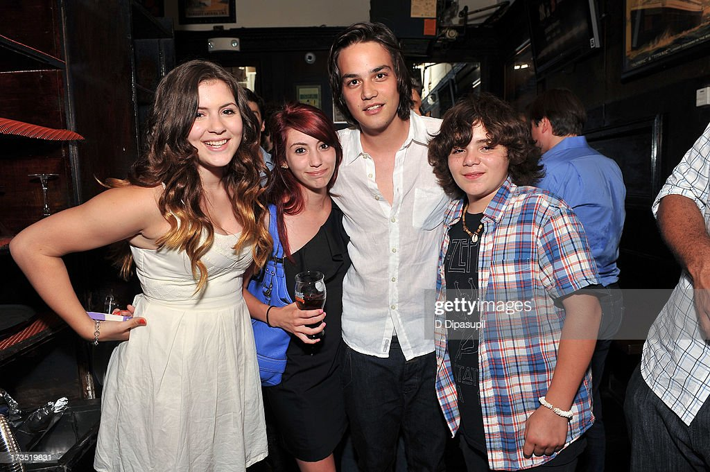 Actor Daniel Zovatto (2nd R) poses with guests during the Glass Eye Pix 'Beneath' Premiere Event - After Party at Oliver's City Tavern on July 15, 2013 in New York City.