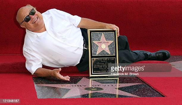 Actor Danny DeVito poses for photographers during the installation ceremony for his star on the Hollywood Walk of Fame on August 18 2011 in Hollywood...