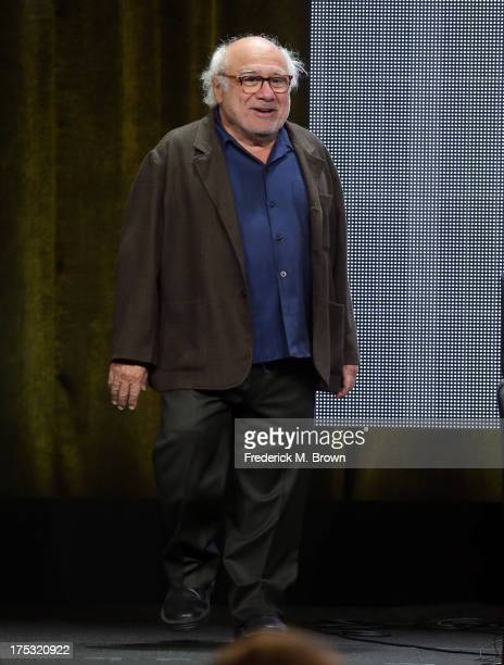 Actor Danny DeVito walks onstage during the 'It's Always Sunny in Philadelphia' panel discussion at the FX portion of the 2013 Summer Television...