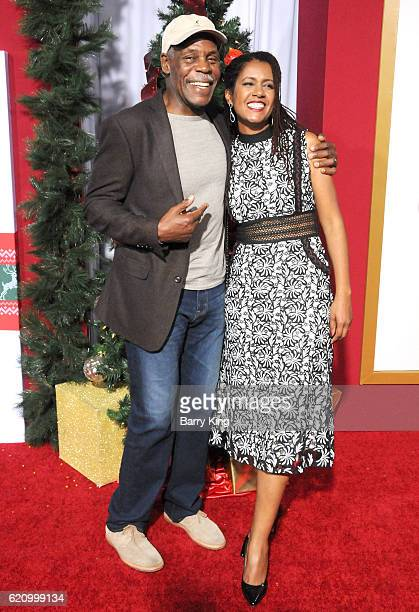 Actor Danny Glover and Elaine Cavalleiro attend the premiere of Universal's 'Almost Christmas' at Regency Village Theatre on November 3 2016 in...