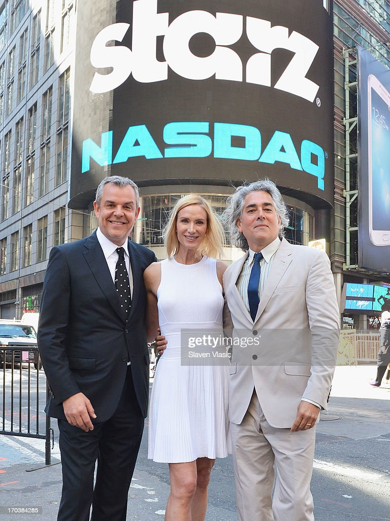 Actor Danny Huston, actress Kelly Lynch and creator/writer Mitch Glazer pose outside of NASDAQ at Times Square on June 12, 2013 in New York City.