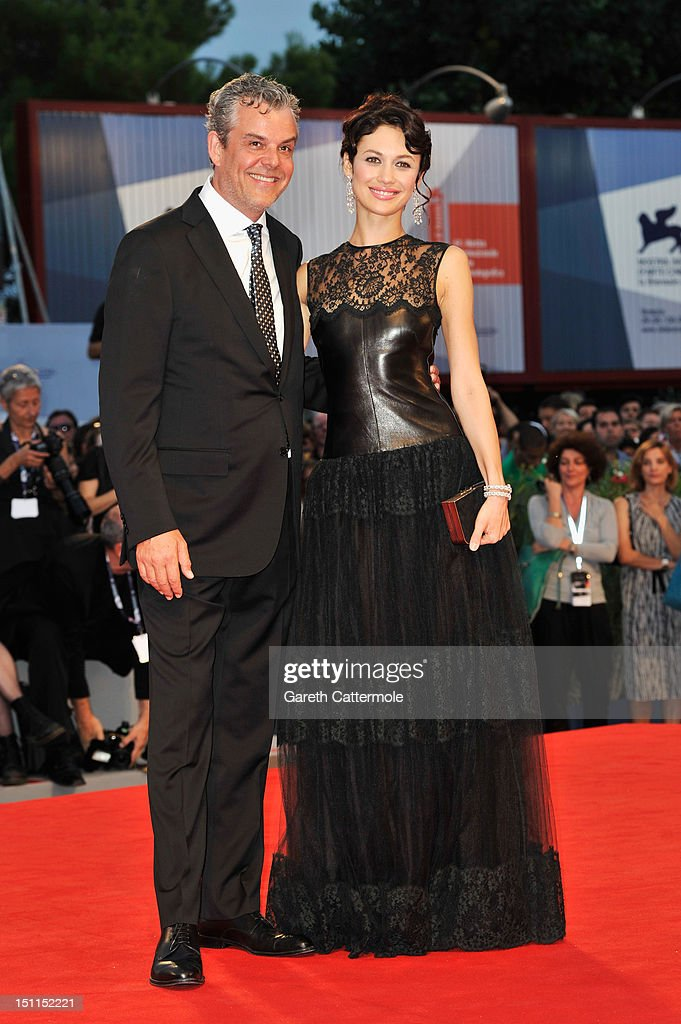 Actor <a gi-track='captionPersonalityLinkClicked' href=/galleries/search?phrase=Danny+Huston&family=editorial&specificpeople=211465 ng-click='$event.stopPropagation()'>Danny Huston</a> and actress <a gi-track='captionPersonalityLinkClicked' href=/galleries/search?phrase=Olga+Kurylenko&family=editorial&specificpeople=630281 ng-click='$event.stopPropagation()'>Olga Kurylenko</a> attend the 'To The Wonder' Premiere during the 69th Venice Film Festival at the Palazzo del Cinema on September 2, 2012 in Venice, Italy.