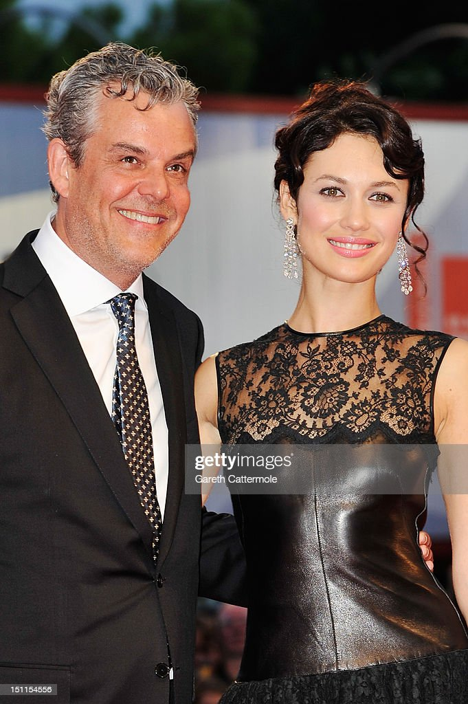 Actor Danny Huston and actress Olga Kurylenko attend the 'To The Wonder' Premiere during the 69th Venice Film Festival at the Palazzo del Cinema on September 2, 2012 in Venice, Italy.
