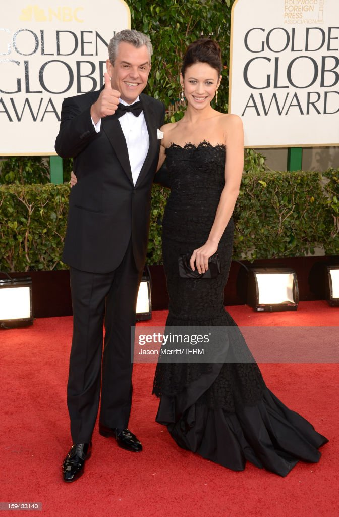 Actor Danny Huston (L) and guest arrive at the 70th Annual Golden Globe Awards held at The Beverly Hilton Hotel on January 13, 2013 in Beverly Hills, California.